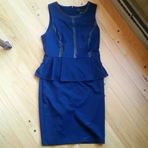 Blue knit dress with faux leather trim.